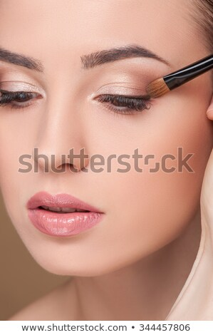 Close up look of applying eyeshadow with applicator stock photo © imarin