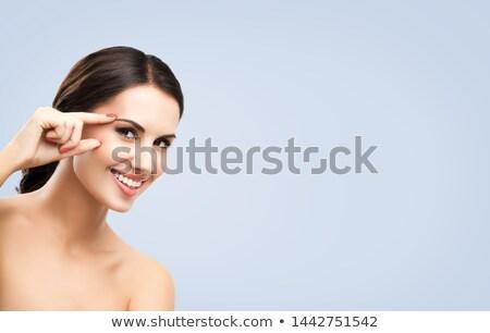 Attractive brunette applying hand cream Stock photo © photography33