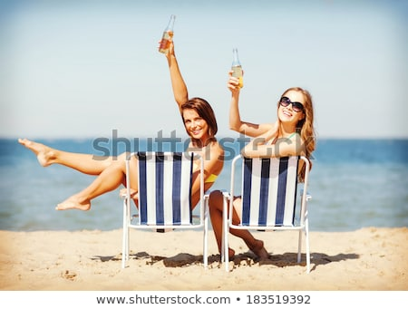 chilling on a sunlounger Stock photo © bmwa_xiller