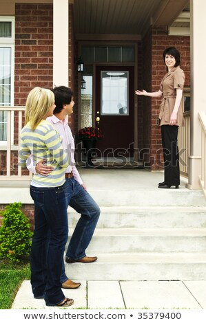Friendly estate-agent welcoming couple Stock photo © photography33
