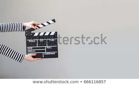 woman with movie slate stock photo © photography33