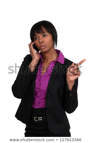 beautiful black woman on the phone pointing sideways Stock photo © photography33