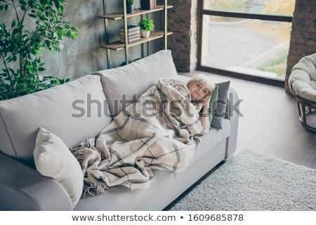 Blond woman having a nap on sofa Stock photo © photography33