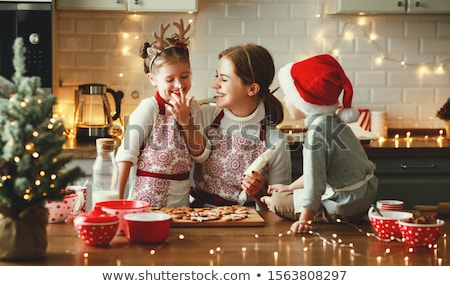beautiful woman is baking cookies for christmas stock photo © juniart