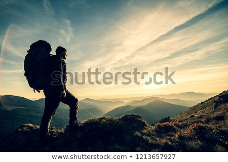 Sportsman is standing on top of hill Stock photo © vetdoctor