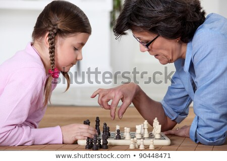Young girl playing chess with grandma Stock photo © photography33