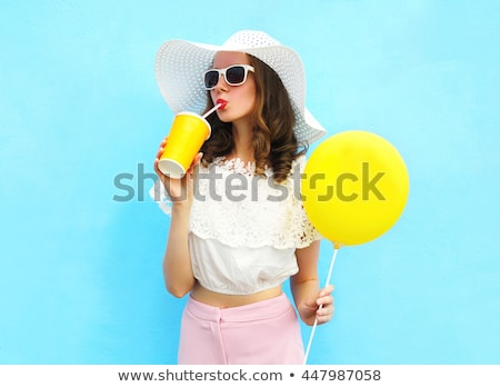 hat girl with drink stock photo © carlodapino