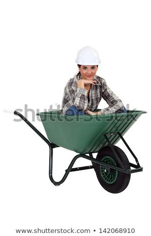 Tradeswoman sitting in a wheelbarrow Stock photo © photography33