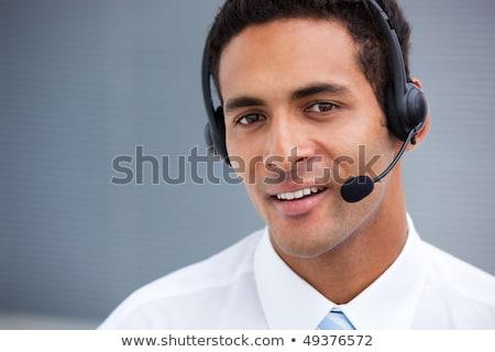 Klantenservice vertegenwoordiger hoofdtelefoon witte vrouw glimlach Stockfoto © wavebreak_media