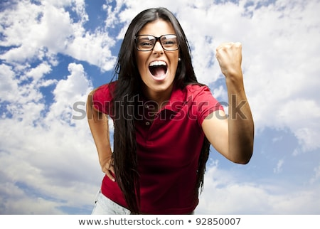 Young woman punching the air outdoor  Stock photo © wavebreak_media