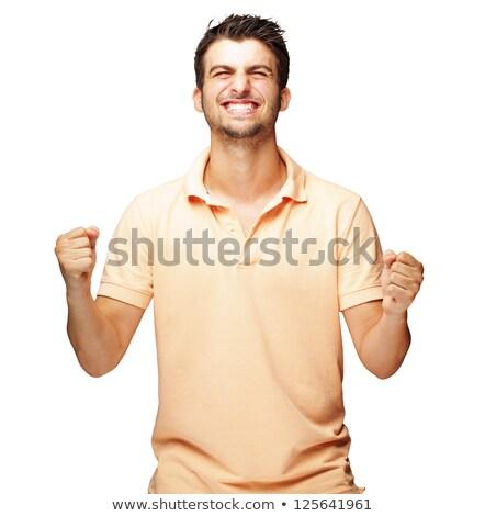 улыбаясь · человека · кулаком · вверх · белый · моде - Сток-фото © wavebreak_media