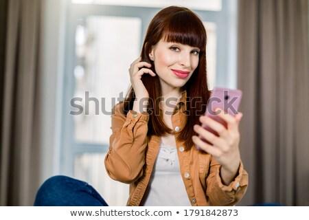 retrato · mulher · usando · laptop · telefonema · quarto - foto stock © wavebreak_media