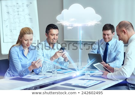 happy woman with tablet computer and clouds stock photo © elenaphoto