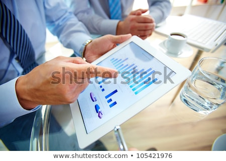Stok fotoğraf: Hand And Tablet Computer With Business Graph