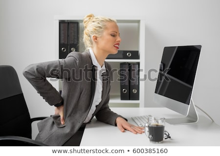 Unhappy young woman with a terrible back pain Stock photo © pablocalvog