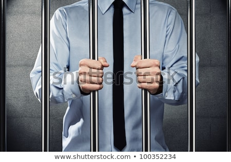 Young man behind the bars Stock photo © AndreyKr
