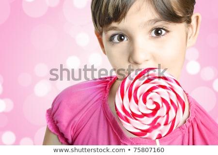 Sorridente little girl pirulito doce mão ao ar livre Foto stock © lunamarina