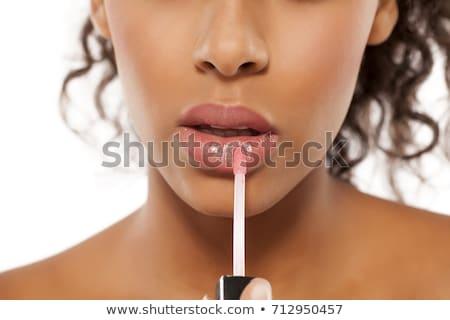lápiz · labial · rojo · labios · mujer · primer · plano - foto stock © stryjek
