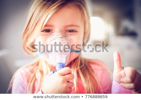 little girl using inhaler Stock photo © mady70