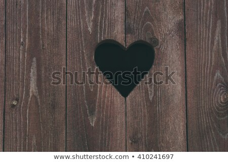 Heart shape look out on wooden door to outhouse.   Stock photo © meinzahn