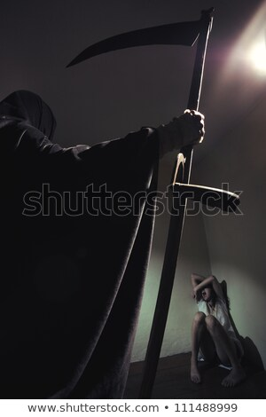 Stock photo: dangerous woman with Scythe