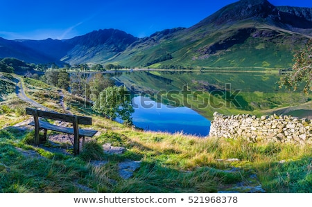 reflection on lake district hills in crummock water stock photo © backyardproductions