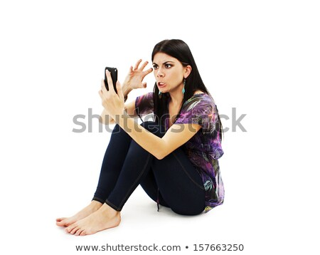 excited pretty girl sending a text message stock photo © stockyimages