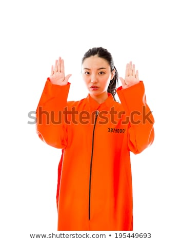 Stock foto: Young Asian Woman Making Stop Gesture Sign From Both Hands In Prisoners Uniform