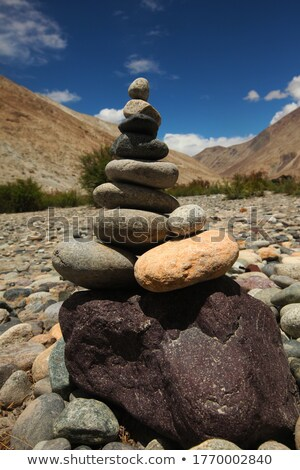stones balancing on top of each to make a tower on a beach Stock photo © chrisga