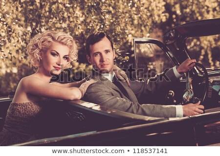 Retro divat pár pózol kint óváros Stock fotó © feelphotoart