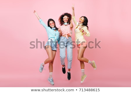 Attractive Asian girl posing and smiling Stock photo © elwynn