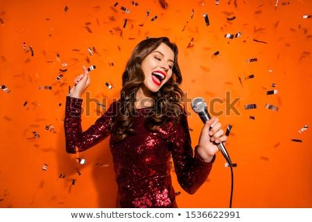 Portré női énekes tart mikrofon gyönyörű Stock fotó © feelphotoart