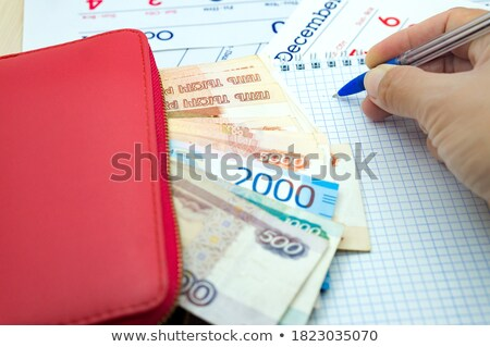 office desk with reports blank notepad and money cash stock photo © karandaev