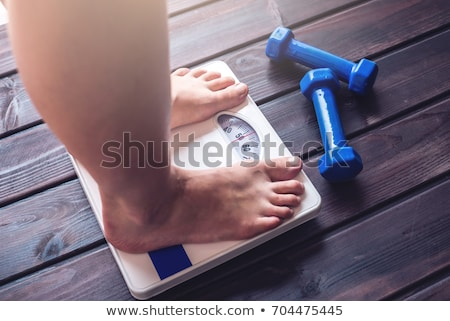overweight woman body and scales stock photo © Mikko