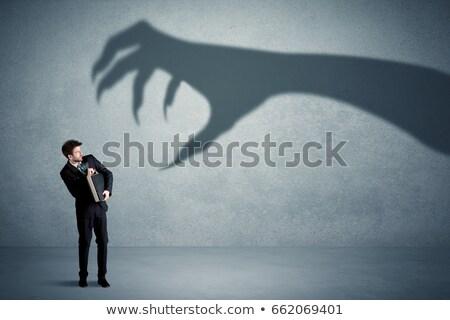 fiatalember · kéz · fej · ijedt · közelkép · portré - stock fotó © fuzzbones0