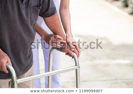 Senior woman using a walker Stock photo © leventegyori