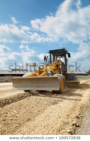 Grader leveling gravel on road construction site Stock photo © inxti