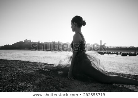 Graceful ballerina in black leotard doing stretching Stock photo © bezikus