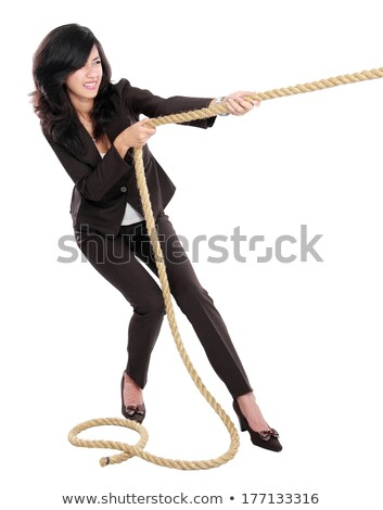 business woman pulling rope Stock photo © dolgachov