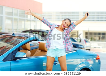 young emotional woman standing near a convertible with the keys stock photo © vlad_star