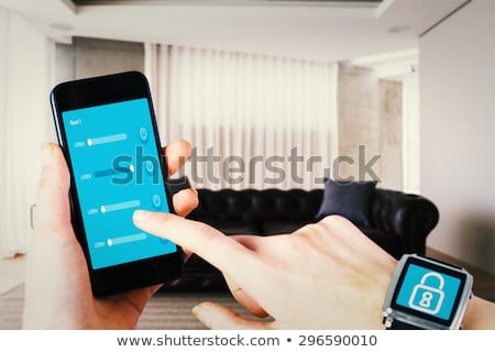 Composite image of woman using smartwatch Stock photo © wavebreak_media