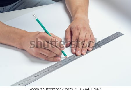 girl draws a pen on a ruler on paper stock photo © dadoodas