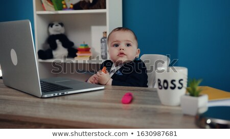 Businessman with mohawk on laptop. Stock photo © iofoto