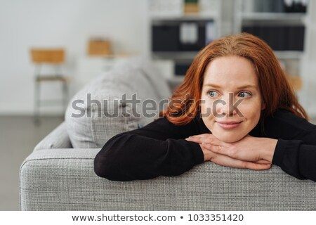 Red Headed  girl thinking on her sofa Stock photo © Giulio_Fornasar