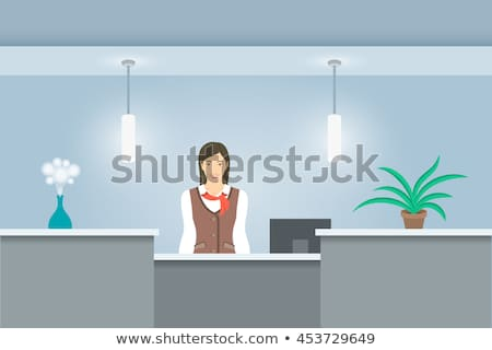 Woman receptionist in uniform stands at reception desk front view Stock photo © vectorikart