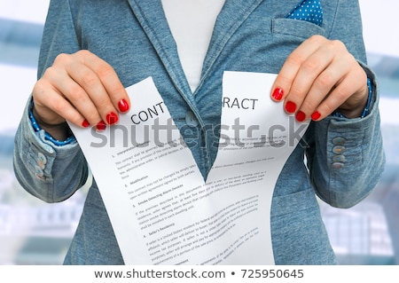 Businesswoman tearing business legal agreement contract Stock photo © stevanovicigor