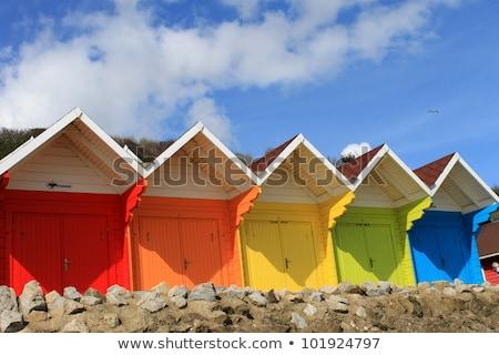 Beach Huts and Rock stock photo © naffarts