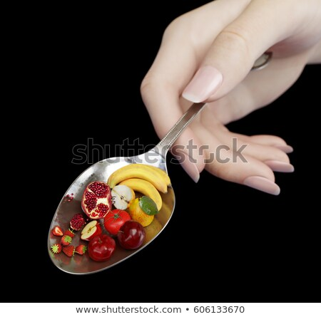Woman Hand Holding Spoon With Fruits On Isolate Black Diet Concept Photo Closeup Stok fotoğraf © denisgo