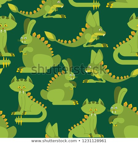 Prehistoric rabbit dinosaur seamless pattern. Dino cat ornament. Stock photo © popaukropa