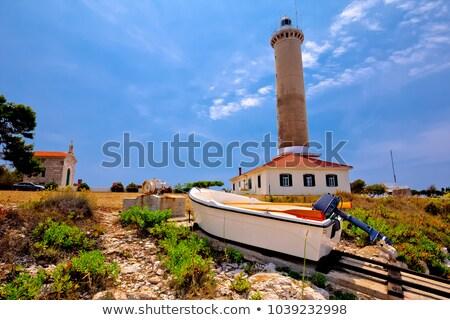 Rato farol barco ilha praia cidade Foto stock © xbrchx